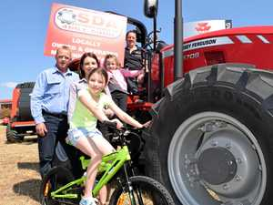 Southern Downs Ag's Rob Collman with Cowboys ambassador Tiffany Cruice, Indigo Cruice on the bike, Harper Cruice and Gary Watt from Warwick Hotel.