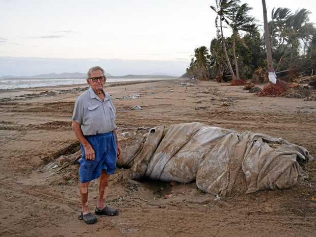 President of the Midge Point Progress Association,  Navio Zeglio, with the damaged geo-fab at Midge Point.