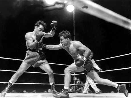Jake LaMotta, right, fighting Marcel Cerdan in Briggs Stadium in Detroit in 1949.