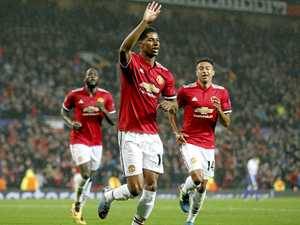 Rashford at the double as United eases through in Cup