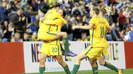 The Matildas celebrate after Sam Kerr scored against Brazil in Newcastle.
