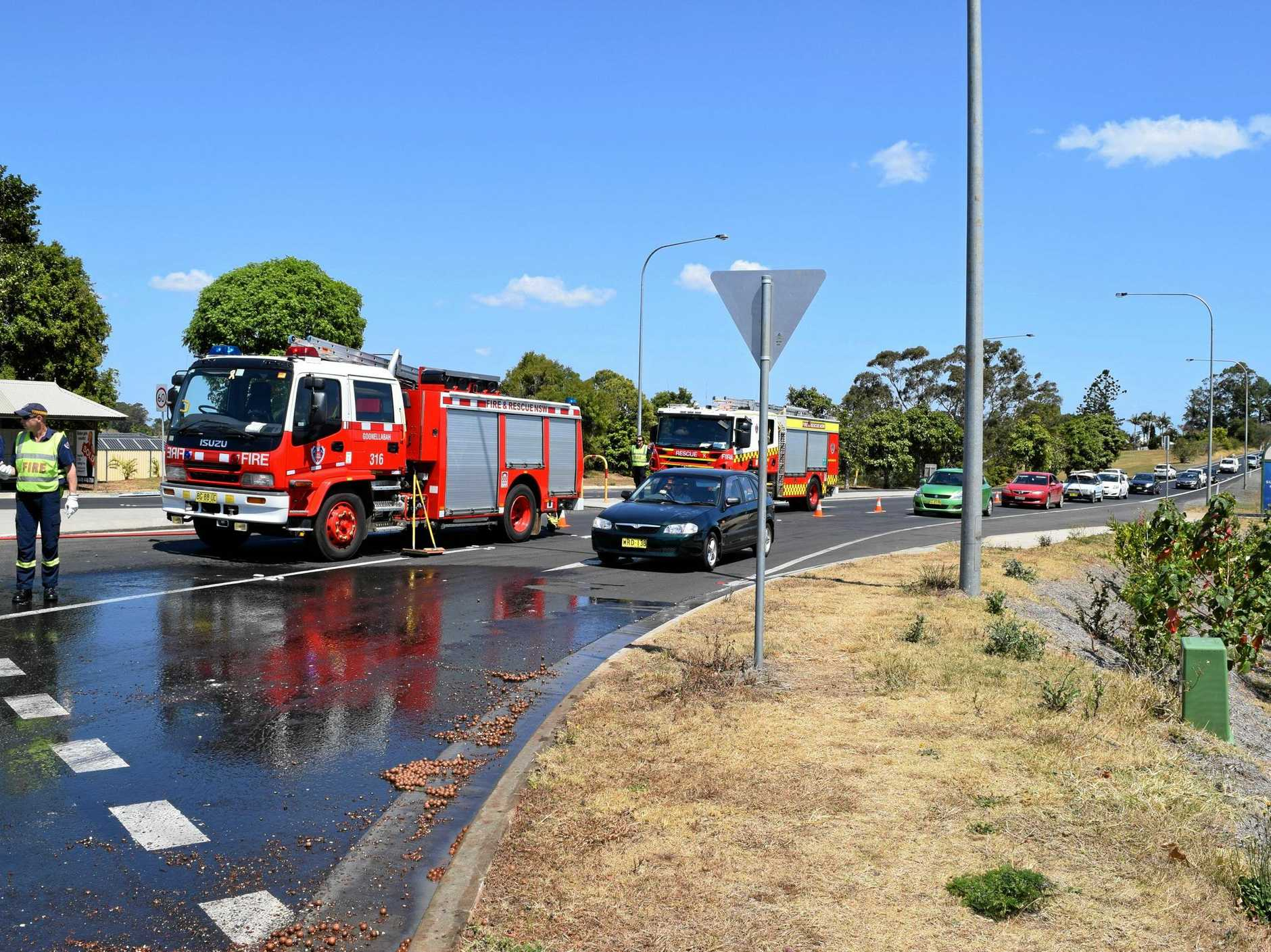 Macadamia nuts on the road halted traffic while emergency services hosed them off.