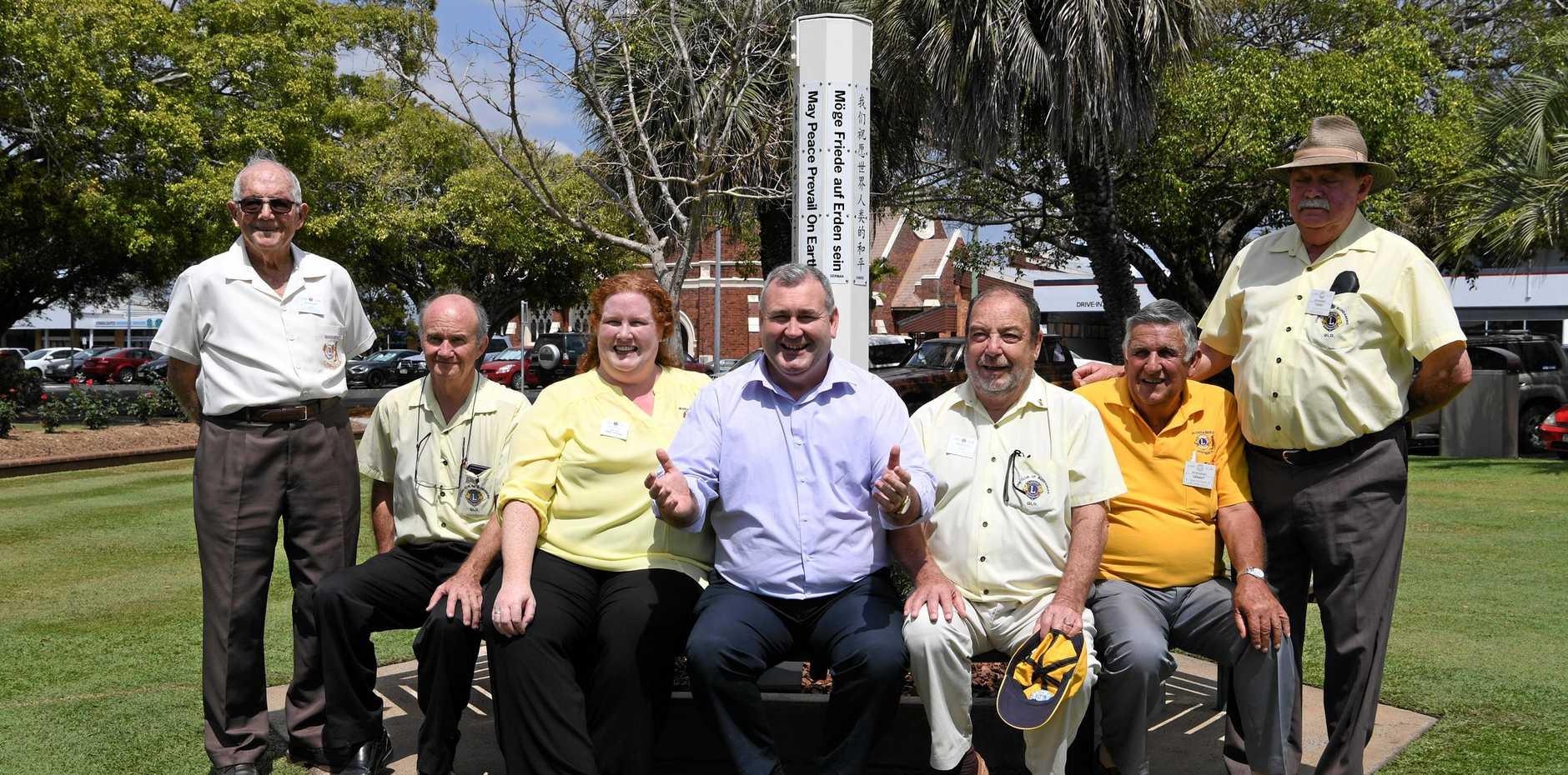 PEACE POLE: Jim Anderson, Alan Williams, Sue Lord, Mayor Jack Dempsey, Rino Gajaldon, Grant Macdonald and Terry Cunningham in Buss Park.