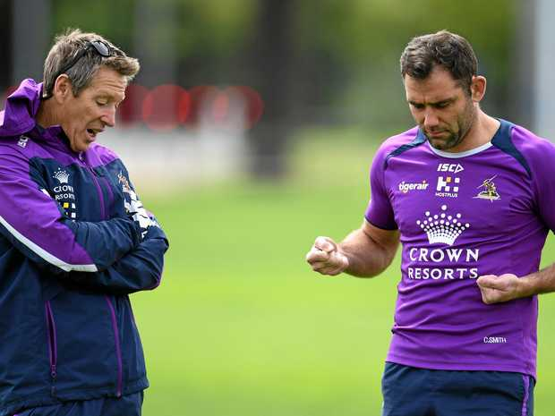 Melbourne Storm coach Craig Bellamy (left) talks with captain Cameron Smith.