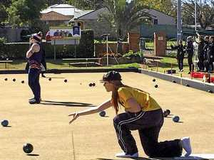 ON THE MAT: USQ student Crystal Hollis-Neath on the lawn bowls green.