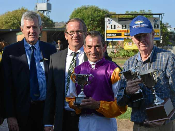 TROPHY HAUL: Deagon trainer Pat Duff and jockey Robbie Fradd with Lismore Turf Club representatives Malcolm Marshall and Mark Oaten.