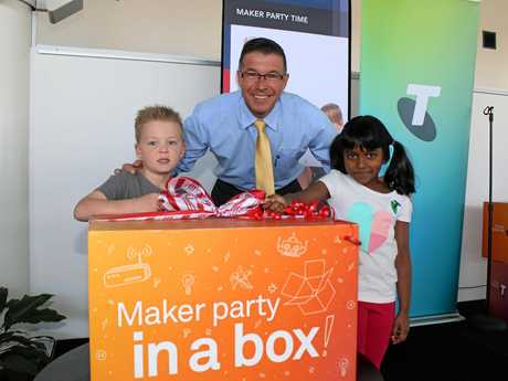 Aiden Crook and Sithuki Hewamadduma open the Maker Party in a Box with Mayor Andrew Antoniolli.