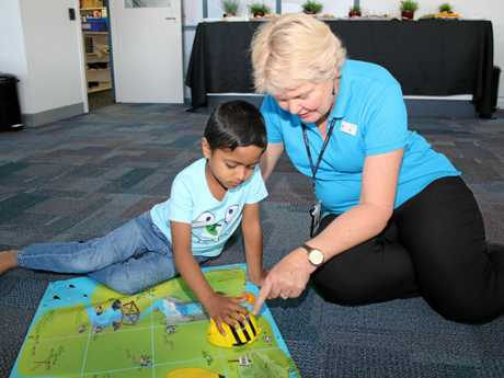 Janiru Hewamadduma gives technology a try with the help of library officer Sue Cicolini.