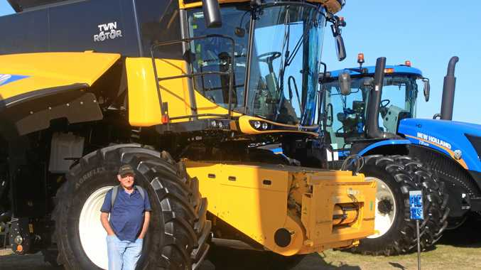 PUTTING THINGS IN PERSPECTIVE: Graham Hunt is dwarfed by some big machinery at Agquip Expo at Gunnedah.