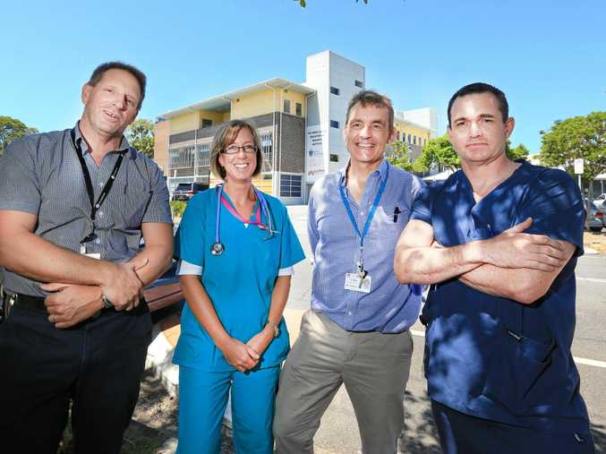 HEALTHY DISCUSSION: Dr Robert Davies, Dr Sarah Limbourn, Dr Mike Lindley-Jones and Dr Alasdair Arthur outside the Tweed Hospital earlier this year.