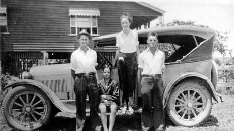 Fred Fink (left) and family members Garth, Lois and Cyril with Fred's first car, a 1925 model Dodge. They are pictured in front of the family home at Yandina.
