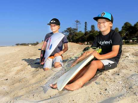 Kingscliff brothers Dane and Guy Henry check the surf at Kingscliff on Tuesday