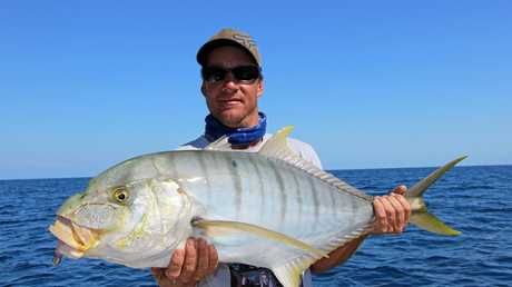 Tim with a solid golden trevally caught in Platypus Bay.