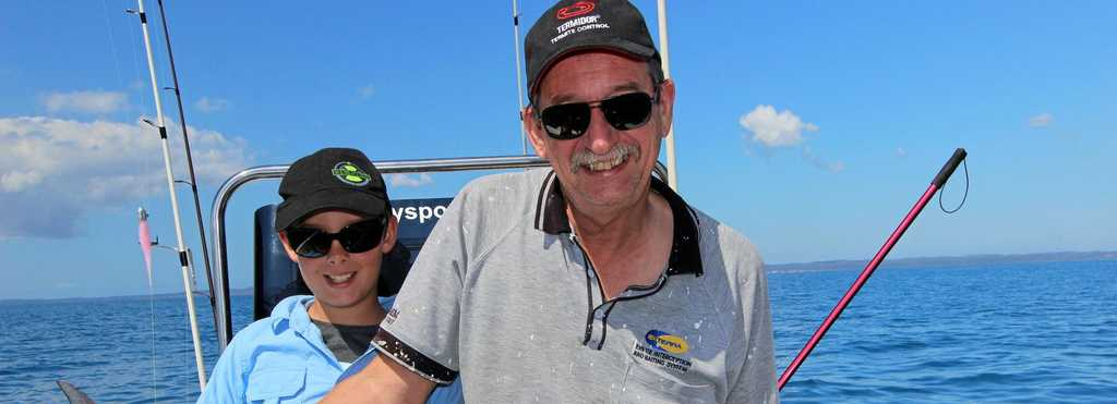 Koby and Brian Chorley enjoying some school holiday fishing with a longtail tuna.