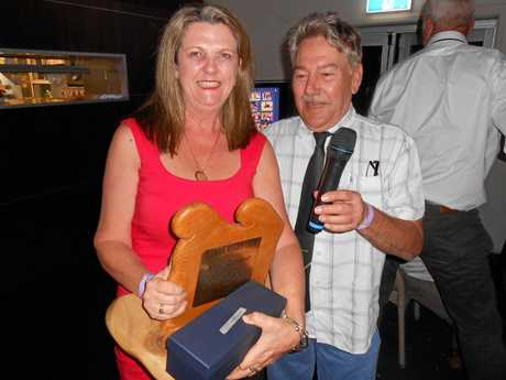 RIGHT: Club supporter of the year Liz Fairweather is award ed the Anne Bennett Supporters Award by life member Andrew Bennett during the   award night at the Pacific Hotel.