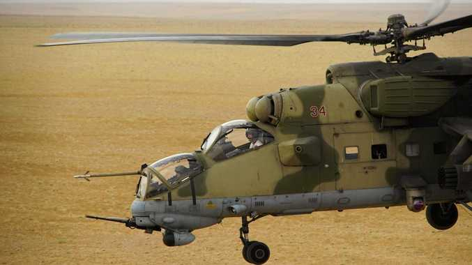 A Russian military helicopter flies over a desert in Deir al-Zor province, Syria. Russian special forces are helping Syrian government troops fight Islamic State militants in the battle under way for the strategic city of Deir al-Zor.