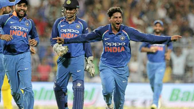 India's Kuldeep Yadav celebrates taking a hat-trick.