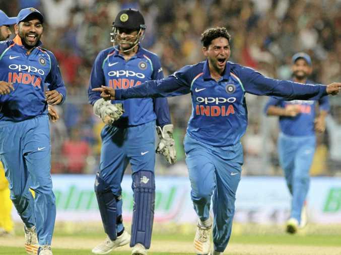 India's Kuldeep Yadav celebrates taking a hat-trick.