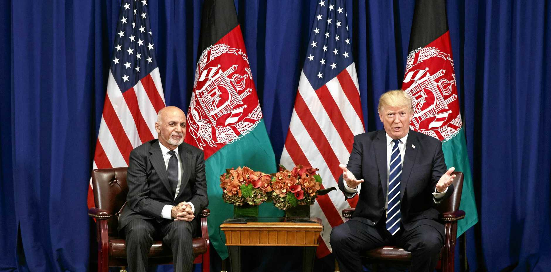 Afghan President Ashraf Ghani meets with US President Donald Trump at the Palace Hotel during the United Nations General Assembly in New York.