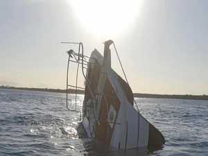 Men swim for their lives after catamaran sinks off Fraser Is