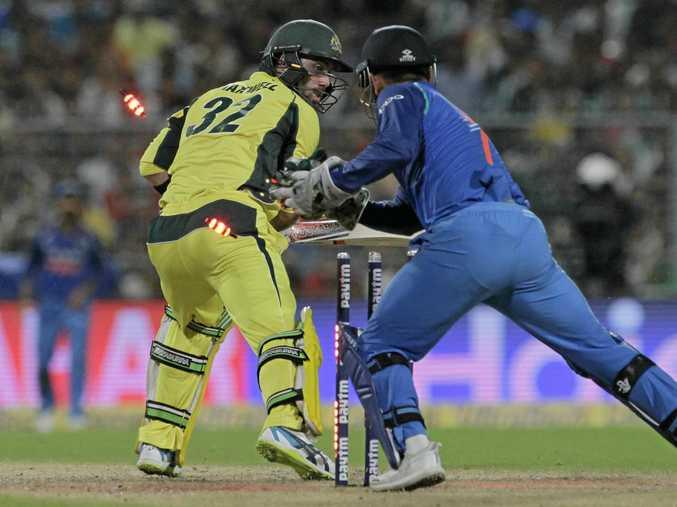 Australian batsmen Glenn Maxwell is stumped by India's Mahendra Singh Dhoni in the one-day clash in Kolkata.