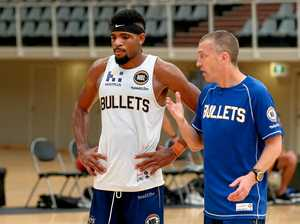 TRAINING RUN: Brisbane Bullets player Perrin Buford with coach Andrej Lemanis.