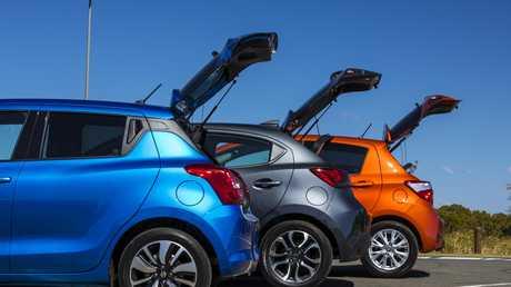 Comparison test between the Suzuki Swift GLX, Toyota Yaris ZR and Mazda2 Genki.