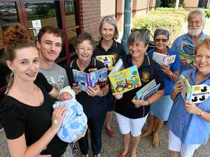 GIFTED: Erica Williamson and Josh Murray with their newborn son and Rotary Club members Lynn Bott, Dianne Riseley, Gay Lavery, Di and Willy Paes and Robyn Dowling with some of the donated books.