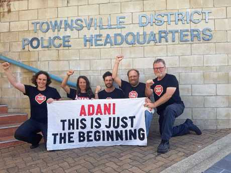Arrestees Donna Smit, Garry Kelly, Moira Williams, John Ross and Joel Rosenveigh Holland outside Townsville Police Headquarters after being charged today.