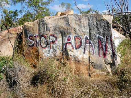 Graffiti left by anti-Adani protesters in Bowen on Bruce Highway around 500 metres north of the West Euri Creek turn-off.