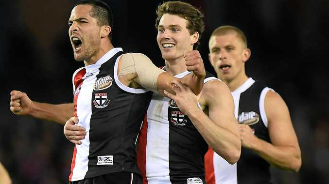 Shane Savage (right) is congratulated by St Kilda teammates Blake Acres and Sebastian Ross.