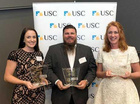 USC's 2017 Outstanding Alumni award winners, from left, Megan Leane, Mathew Davis and Captain Jan Becker.