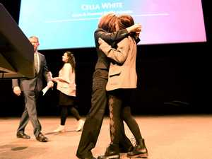 Women kiss on stage in protest at 'No' event