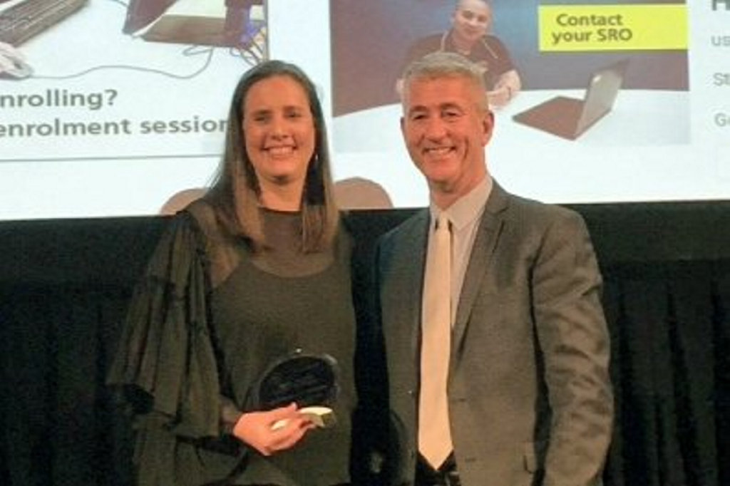 USQ's Fiona Brady accepts the ATEM | Campus Review award for student engagement on behalf of the Student Support and Retention team.