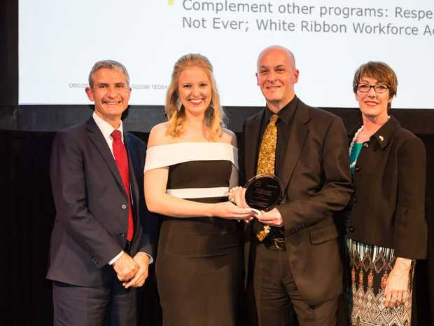 USQ staff members Rachel Hennessy and Peter Munster accept the ATEM | Campus Review award for community engagement on behalf of the USQ Stars Campaign