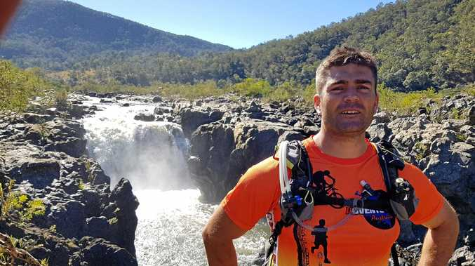 Adventurethon's Joel Savage at the waterfall on a recent reconnaissance trip to the Upper Clarence.