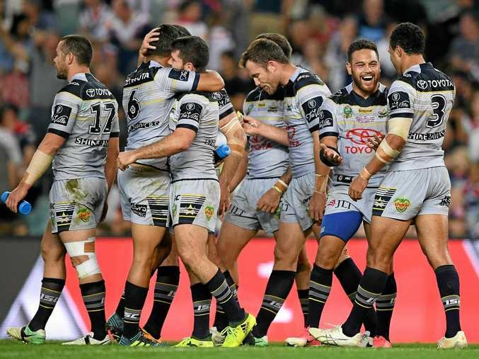 Cowboys players celebrate following their win over the Roosters