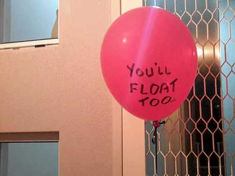 YOU'LL FLOAT TOO: Toogoom resident Jules Hinton was unnerved to find a picture of Pennywise the Dancing Clown and a balloon with 'You'll Float Too' pinned to her door on Friday night.