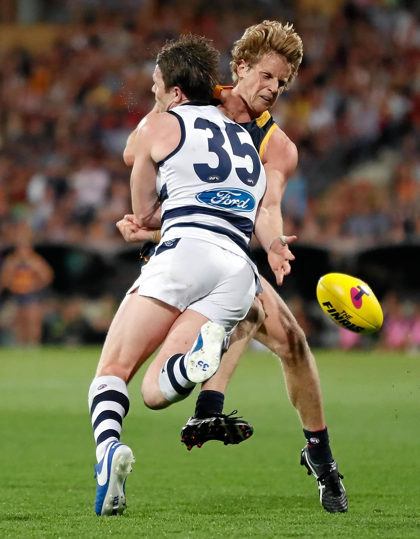 Rory Sloane bumps Patrick Dangerfield.