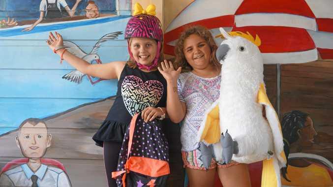 BARGAIN HUNTERS: Taylia Brown, 8, and Eliza Smith, 8, at Op Shop Saturday, Ballina Primary School.