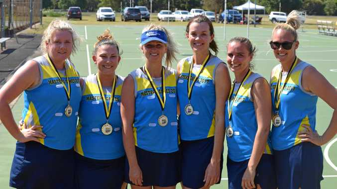 ALL SMILES: Sally Campbell (blue hat) and Heidi Campbell (far right) were part of a winning netball team at the Lismore Workers Masters Games.
