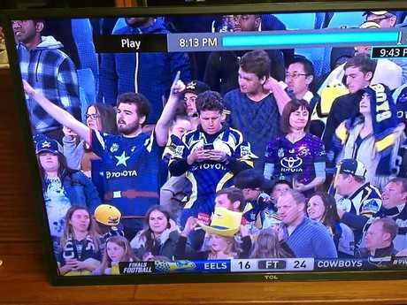 Chris Harvey at ANZ Stadium last week checking his Facebook.