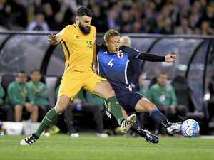 Mile Jedinak, left, is a huge doubt for the clash with Syria next month.