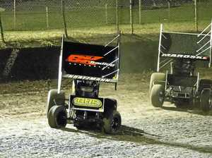 ON TRACK: Brent Kratzmann and Cody Maroske race in the Ultimate Sprintcars Championship at Hi-Tec Oils Speedway.