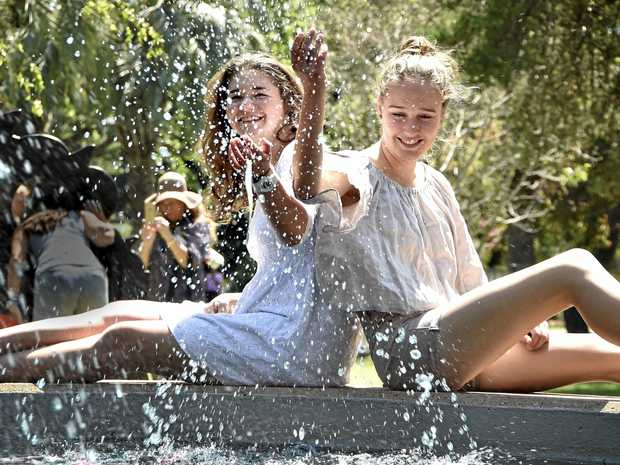 SPLASHING AROUND: Keeping cool in Queens Park are Lara Piovesana (left) and Lucy Ribbie.