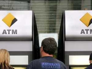 Customers use automatic teller machines (ATM) outside a branch of Commonwealth Bank of Australia. Picture: News Corp AustraliaSource:News Limited