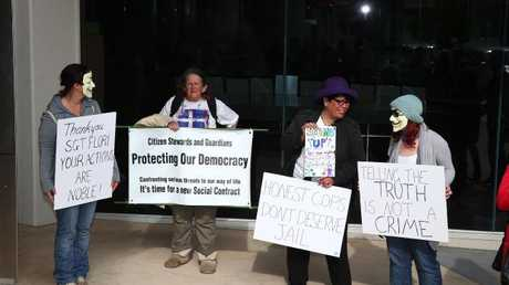 Supporters of Gold Coast police officer Rick Flori protest outside court in 2015 after he appeared to face charges with misconduct over allegations he leaked footage of colleagues bashing a handcuffed man.