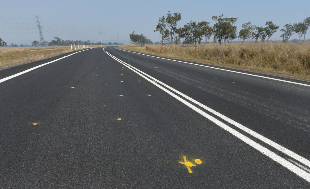 Yellow paint marks the track of a car which crashed on the Burnett Highway near the intersection with R Pierce Road.