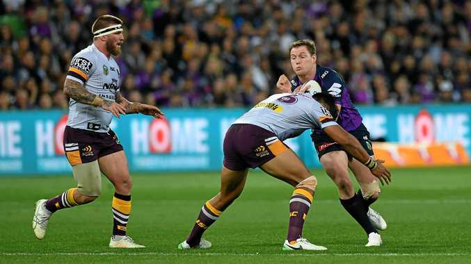 FINALS BOUND: Gladstone product and Melbourne Storm forward Tim Glasby takes on the Brisbane Broncos defence during his side's semi-final victory.