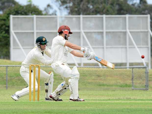 Queensland Premier Grade cricket match between Ipswich Logan Hornets Vs Redlands at Baxter Oval. Dan Wilson makes a marvellous cut shot for four runs.